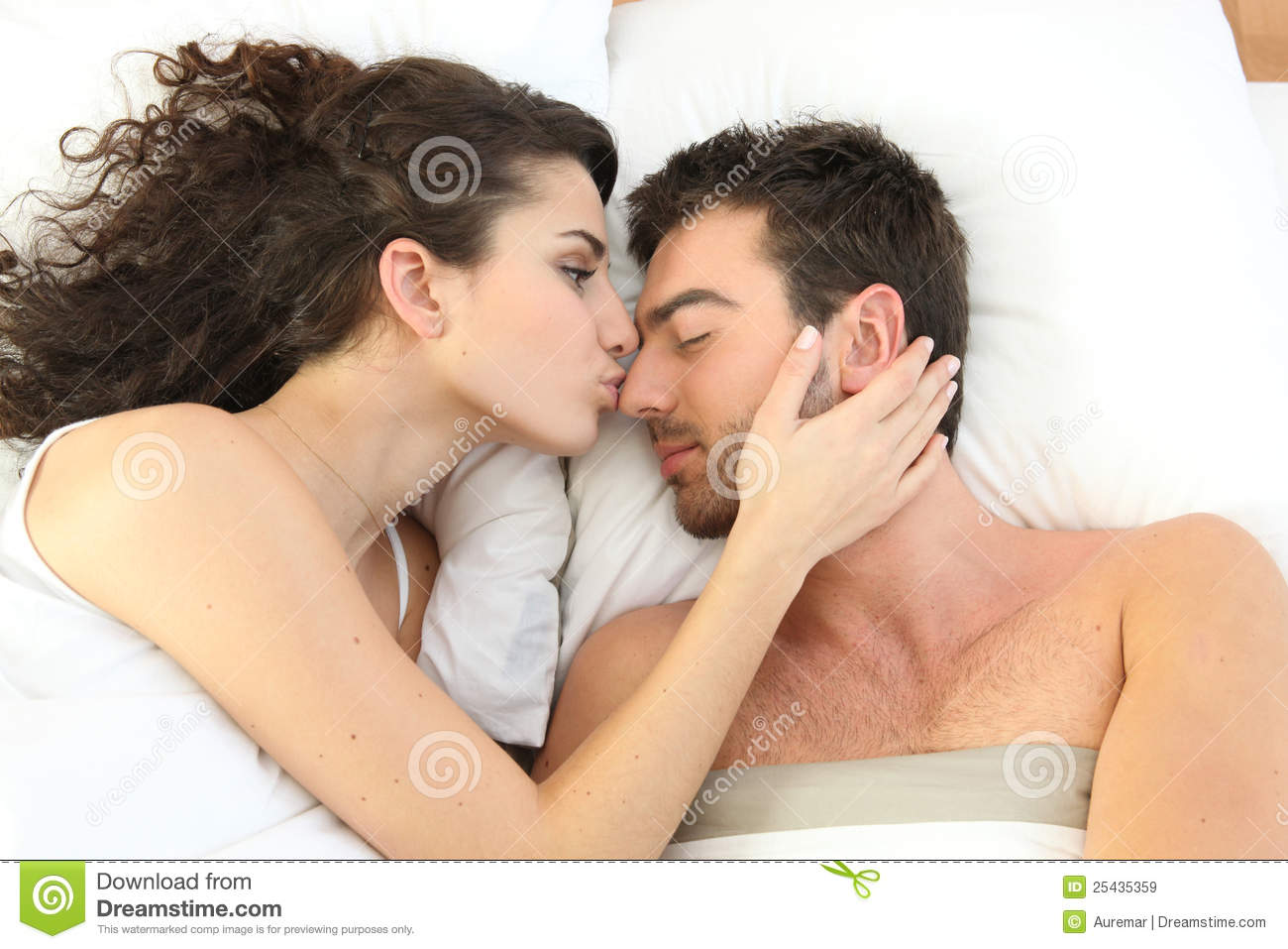 Couple Kissing In Bed Royalty Free Stock Images - Image: 25435359