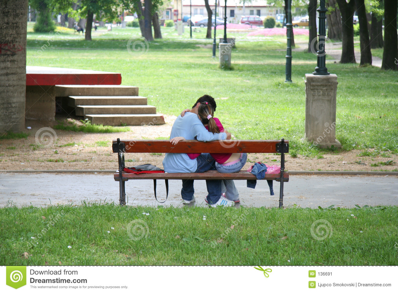 a couple kissing on a bench stock image image of living happy 136691