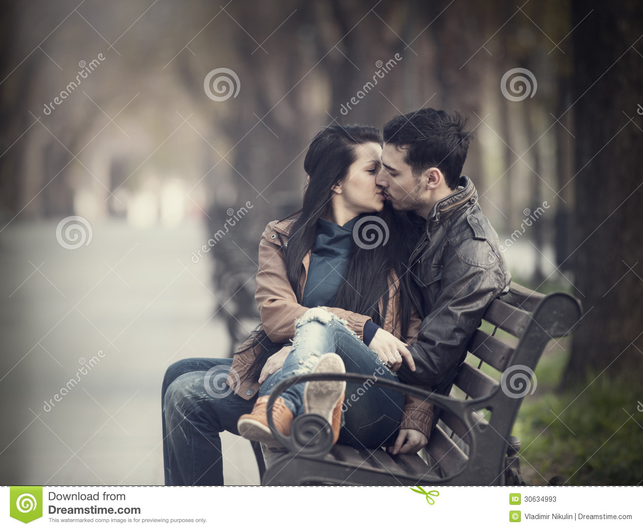 French Kiss Couple Images couple kissing at the bench at alley. stock image - image of france