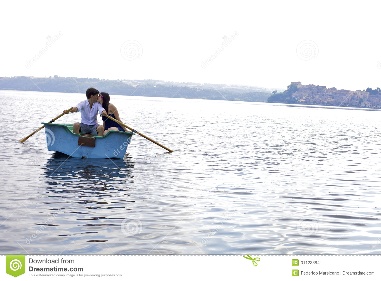 Couple Kissing On Boat In Italian Lake During Vacation Stock Images - Image: 31123884