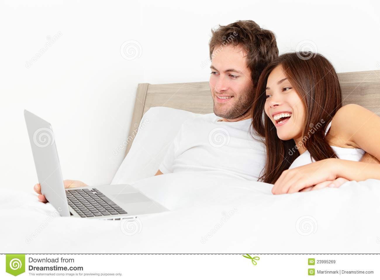 Couple With Laptop In Bed Stock Image Image Of Movie - 23995269-1895