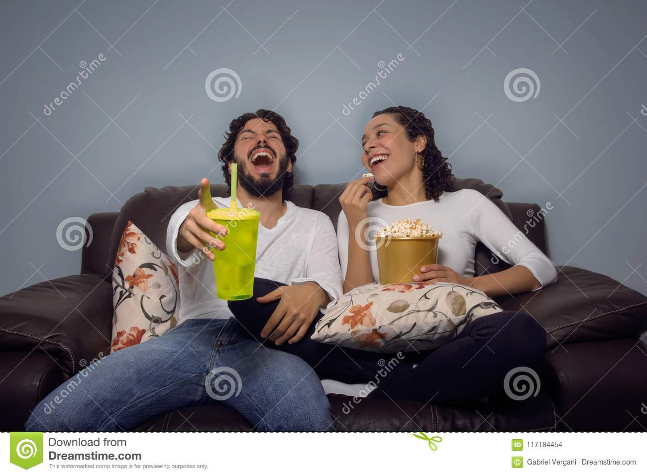 Couple Is Laughing And Watching Movie  Fun At Home, Leisure
