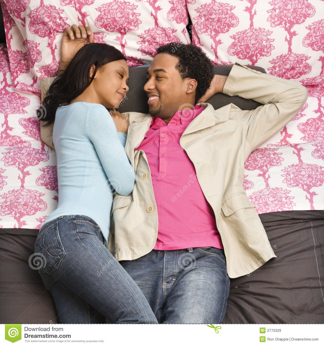 couple laying on bed stock image image of overview length 2770329. Black Bedroom Furniture Sets. Home Design Ideas