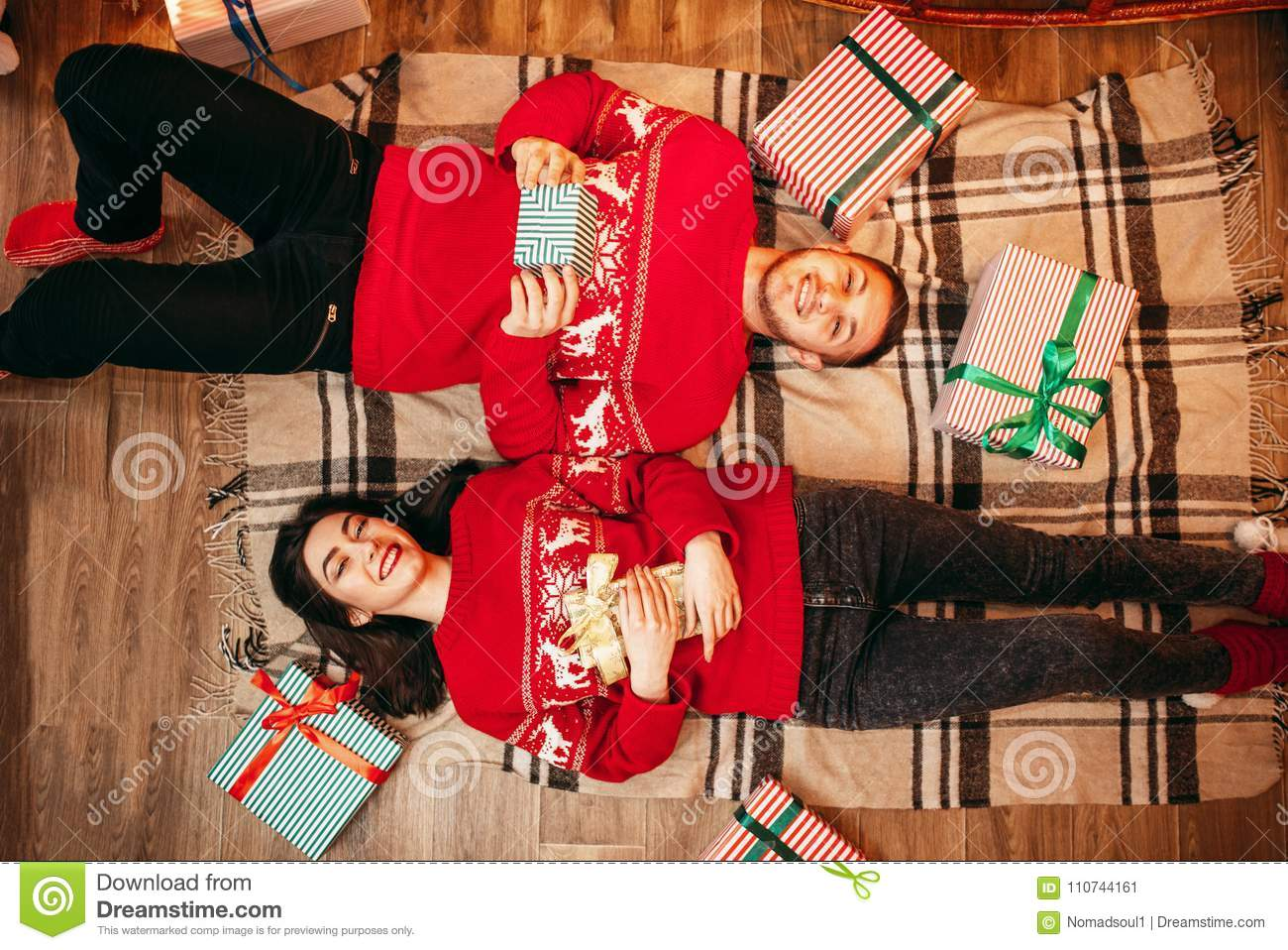 Couple lies on the floor, top view, christmas