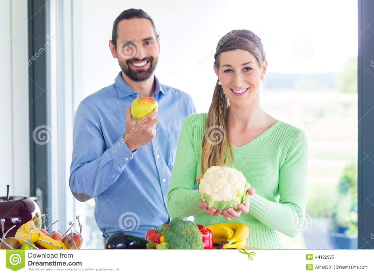 Couple living healthy eating fruits and vegetables
