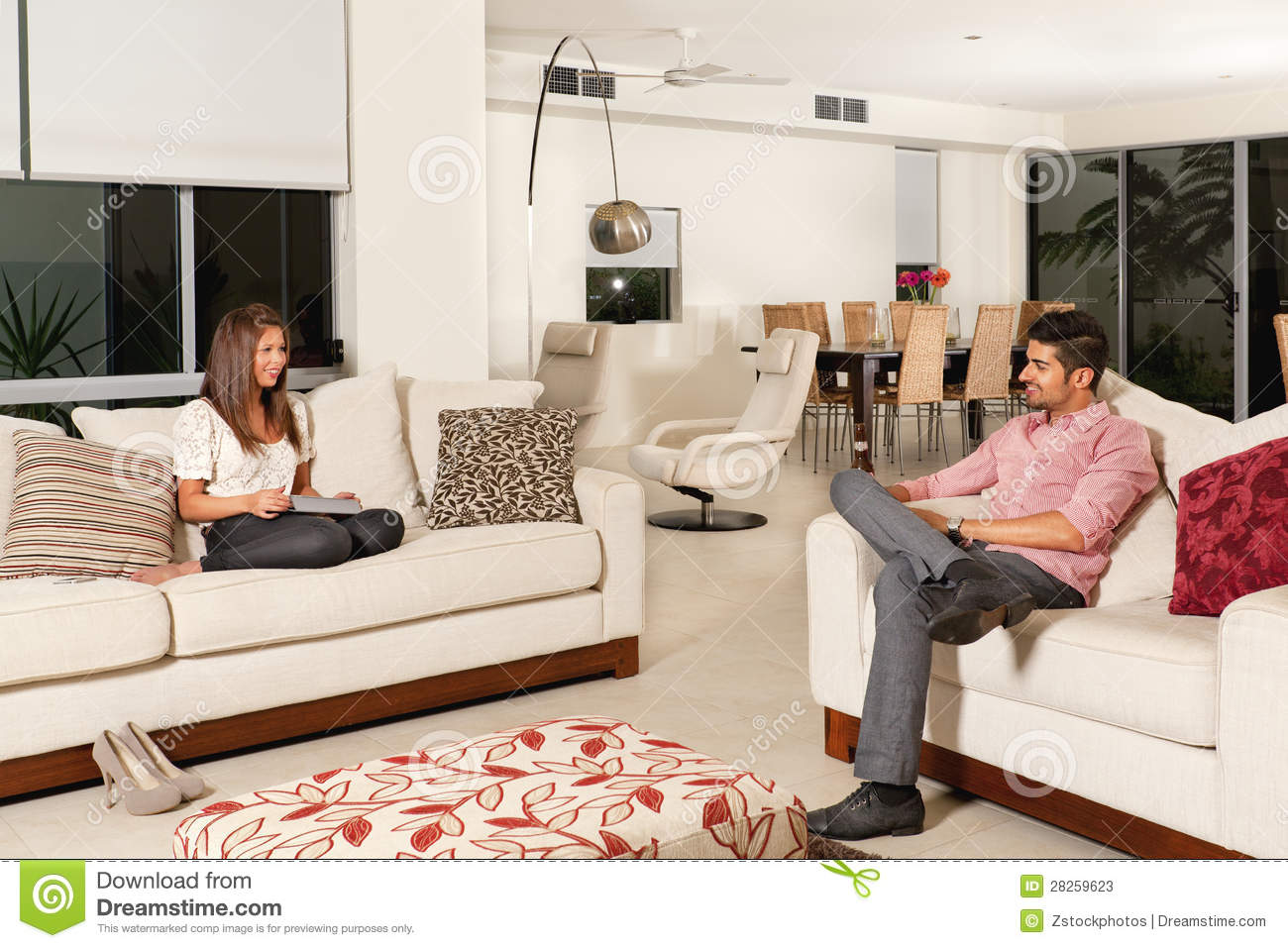 Couple in living room stock photos image 28259623 for Living room ideas for young couples