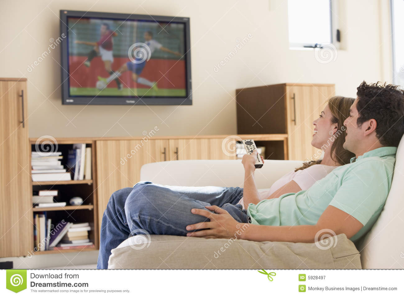 Decorating Ideas > Couple In Living Room Watching Television Royalty Free  ~ 163211_Living Room Ideas Young Couples