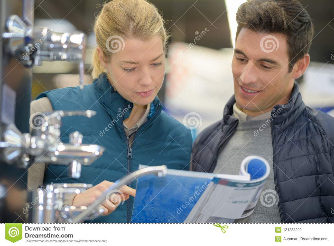 Couple Looking In Catalogue For Faucets Stock Photo - Image of house ...