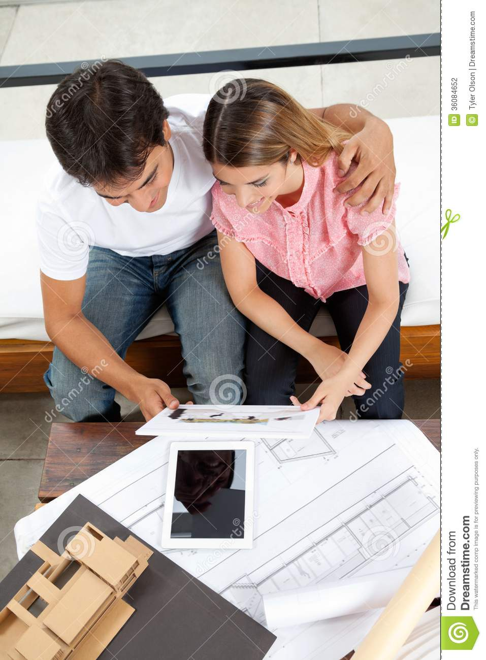 Couple Looking At House Plans Stock Photography   Image  Couple Looking At House Plans