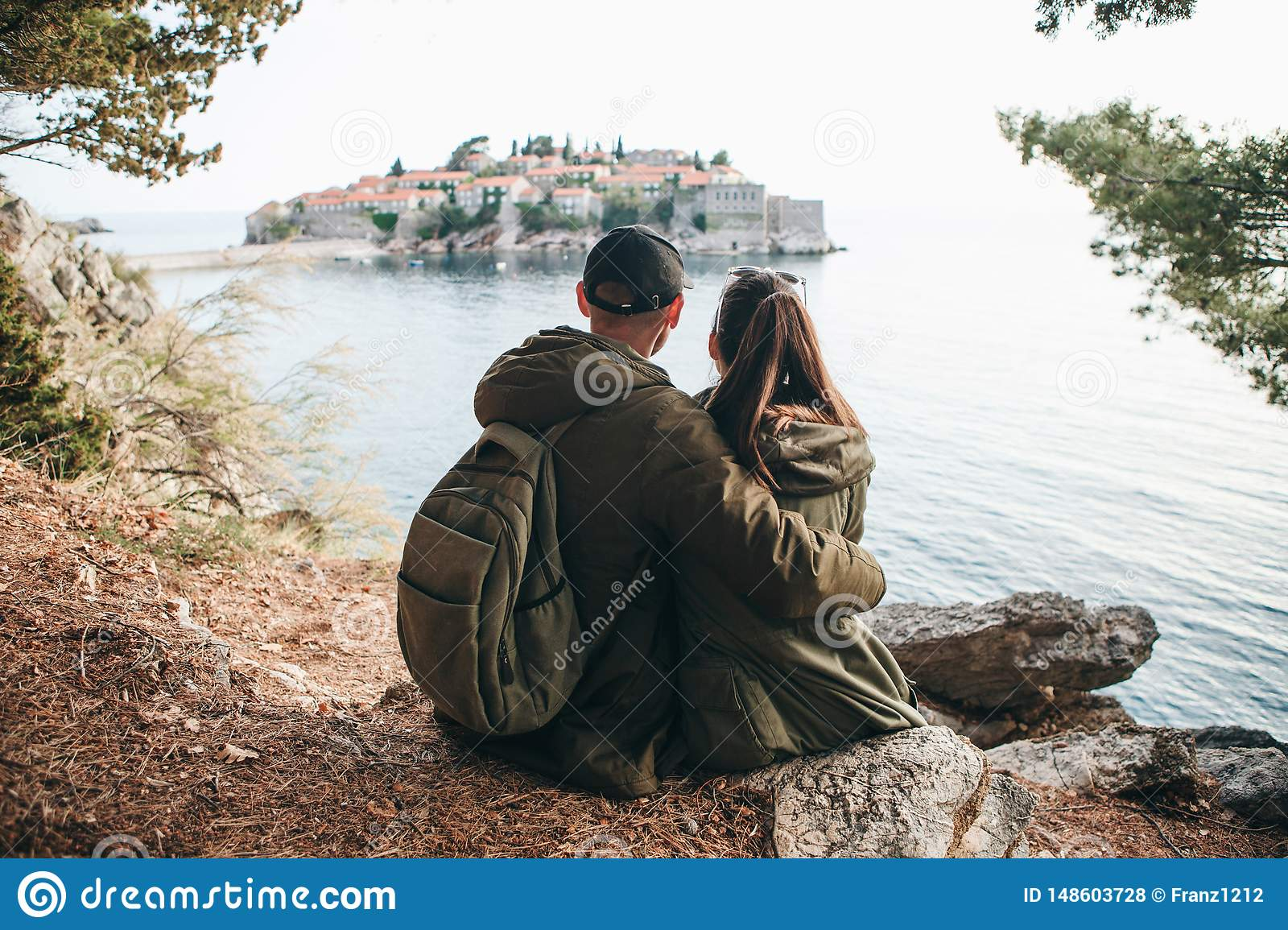 Couple looking at Sveti Stefan