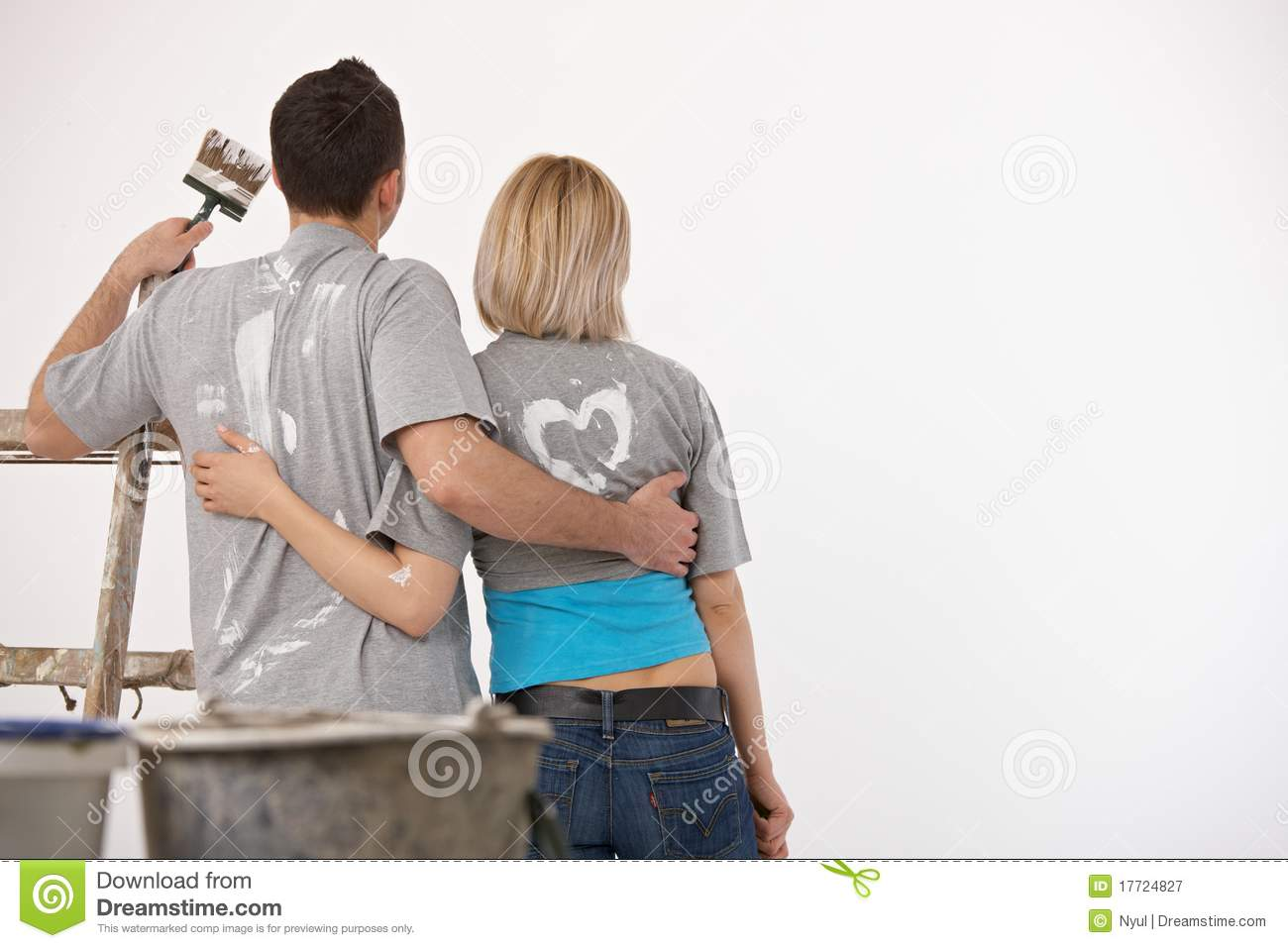 Couple Looking At White Wall After Painting Stock Image