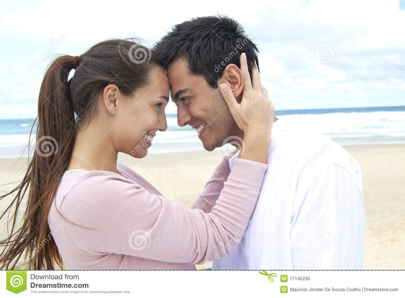 Couple in love on the beach flirting