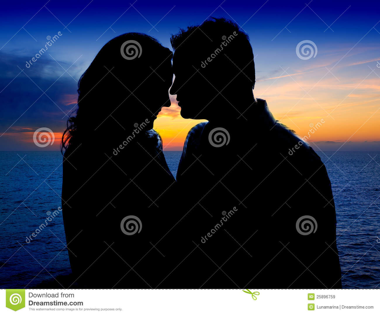 Couple in love hug in suset on sea