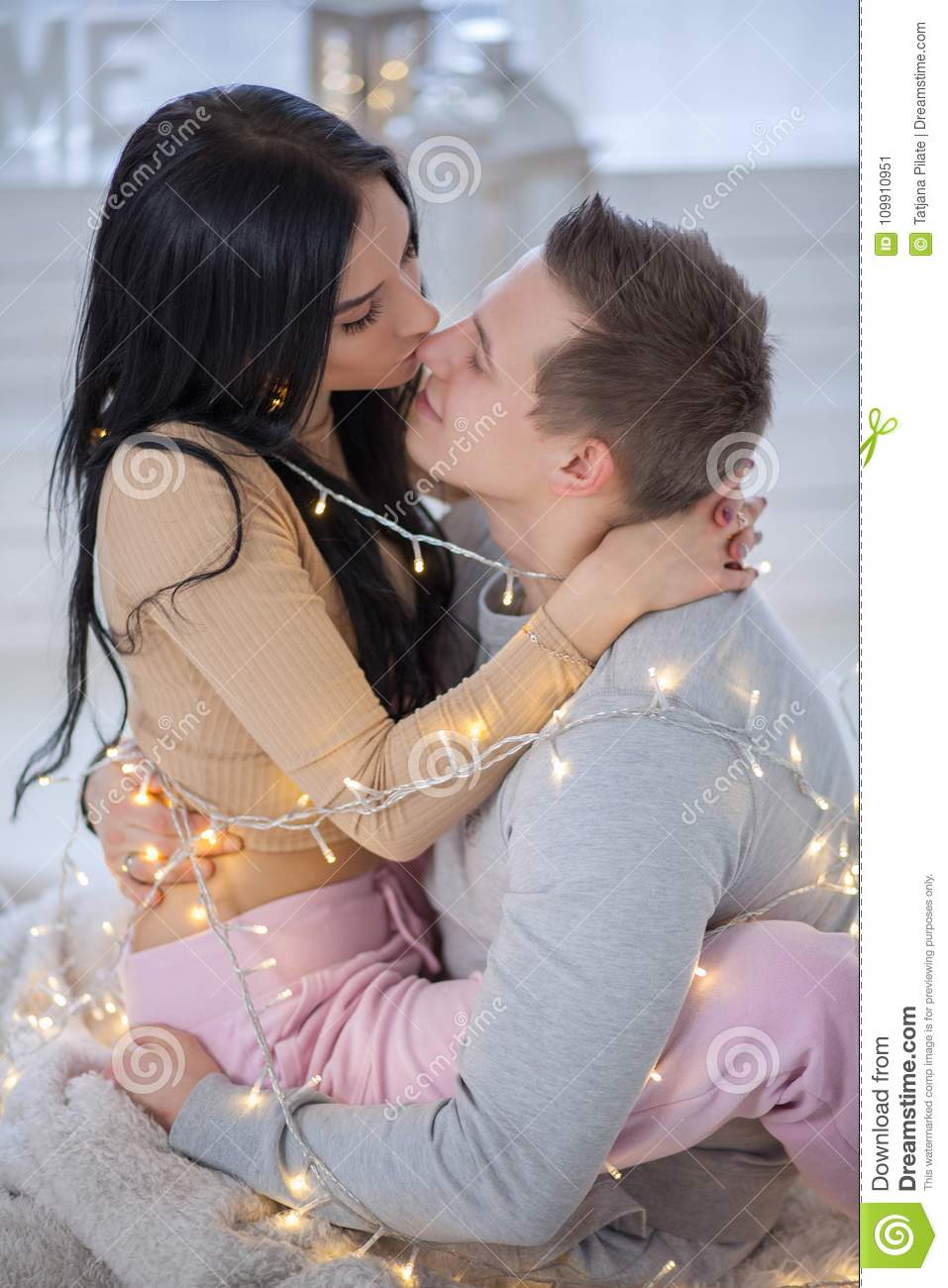 couple in love hugging and kissing stock image image of lights