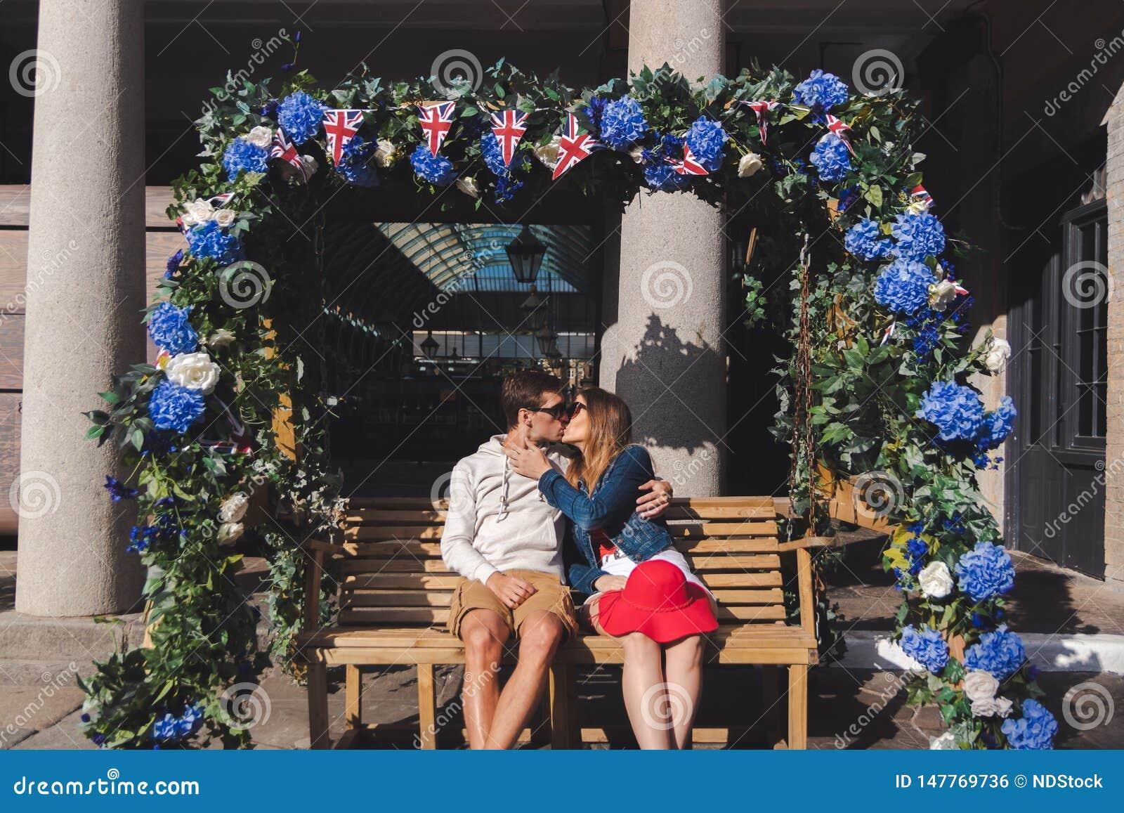 Miraculous Couple In Love Kissing Seated On A Swinging Bench In Covent Inzonedesignstudio Interior Chair Design Inzonedesignstudiocom
