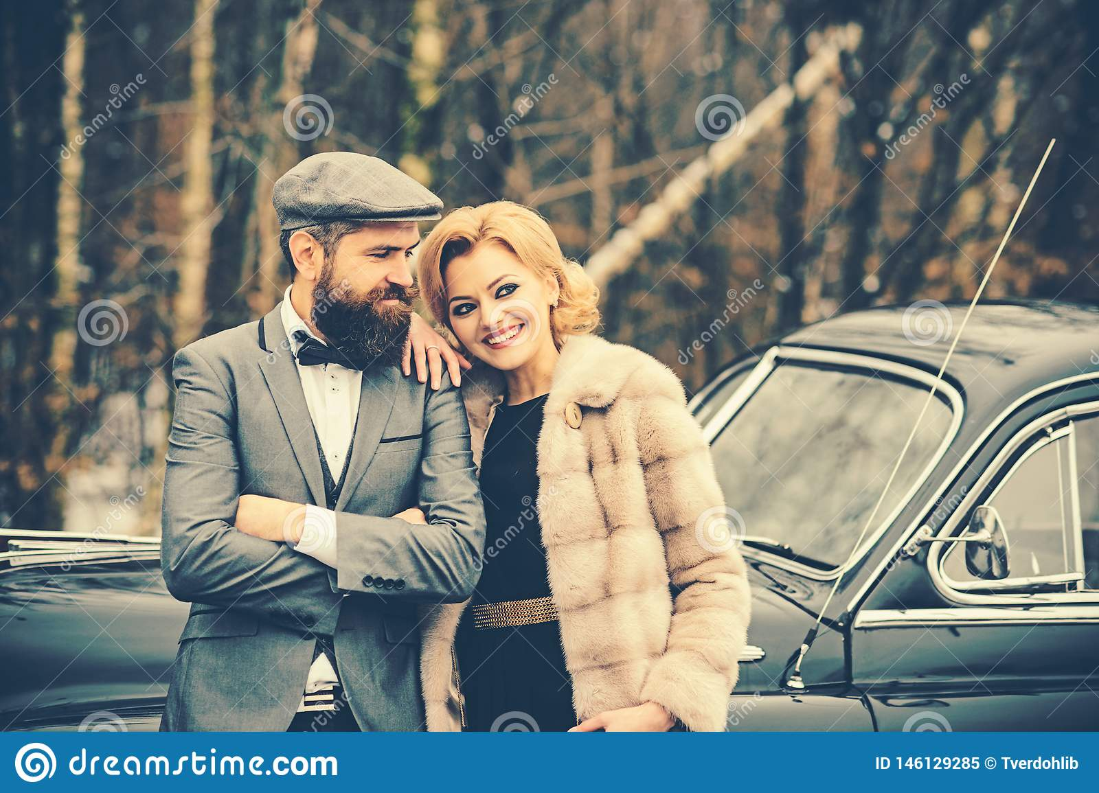 Couple in love on romantic date. Escort of girl by security. Retro collection car and auto repair by mechanic driver