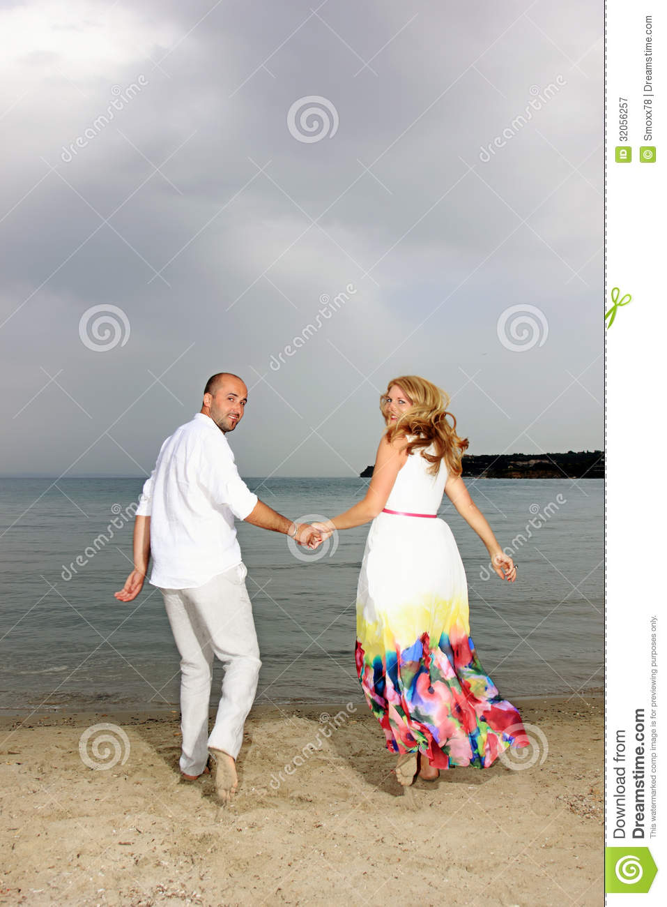 Couple In Love Running While Looking Back Stock Image ...