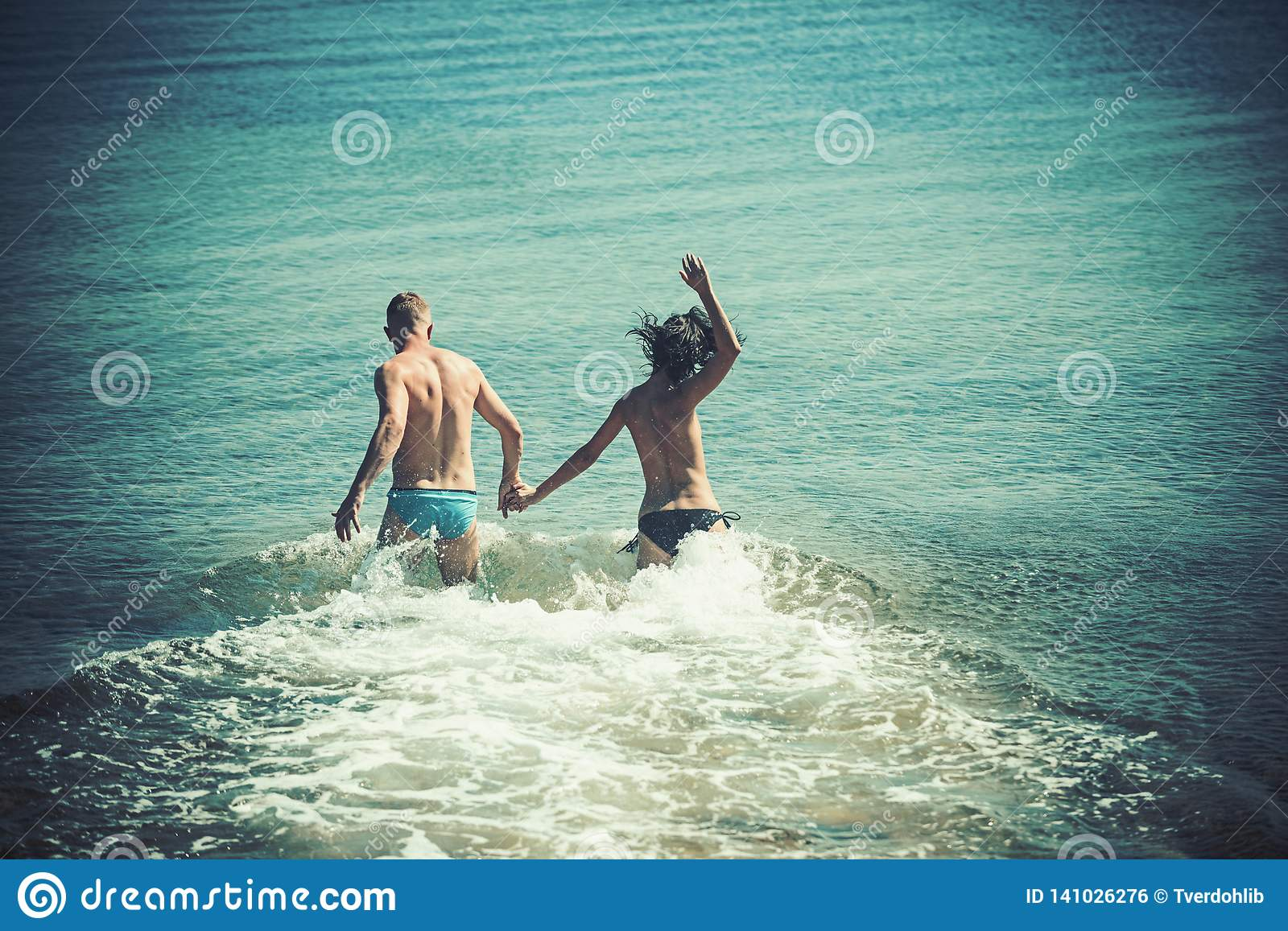 Couple in love with body relax on beach. Summer holidays and paradise travel vacation. woman and man run in
