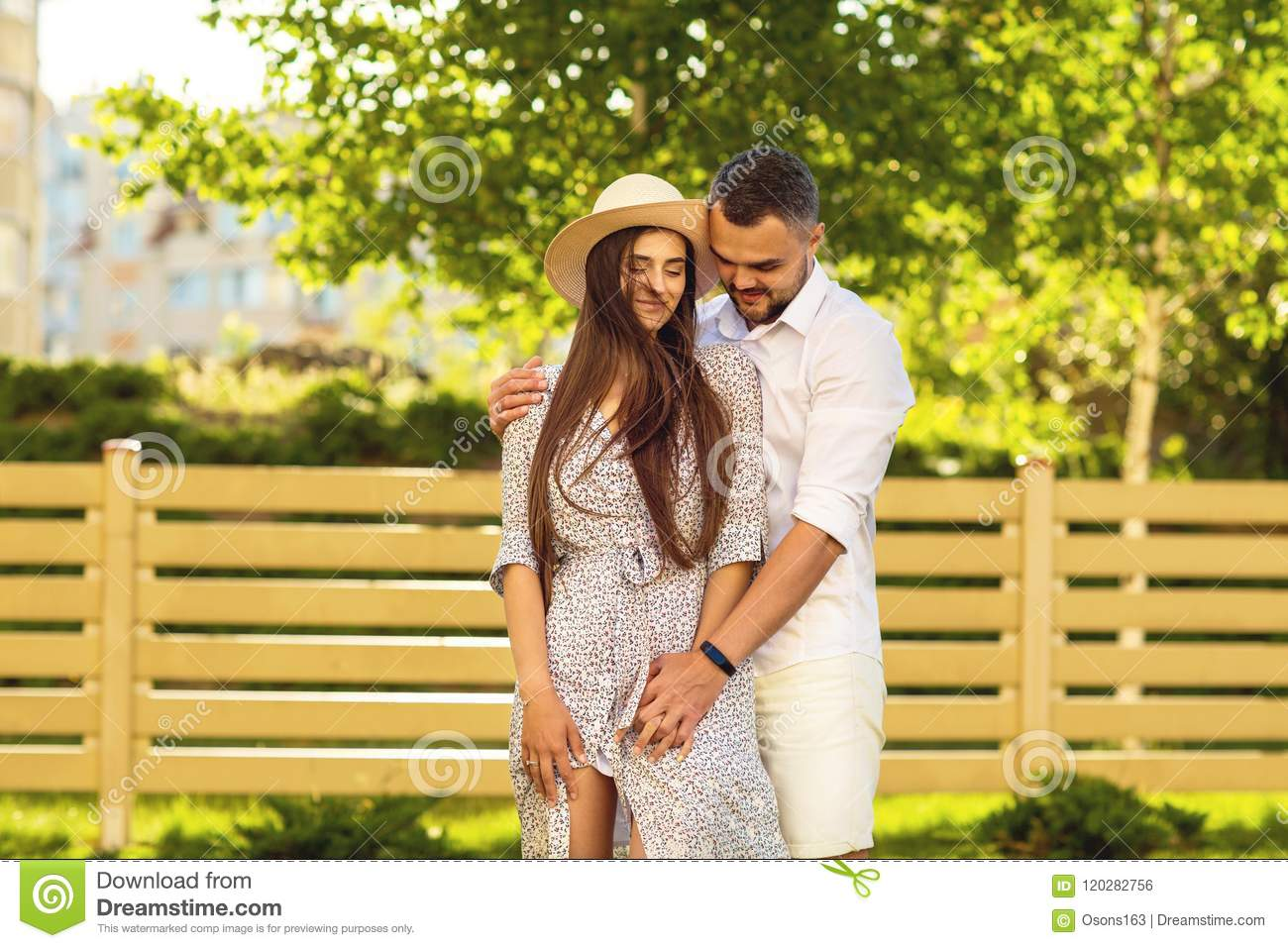 couple in love at sunset walking in the park happy, American dream. The concept of family values.