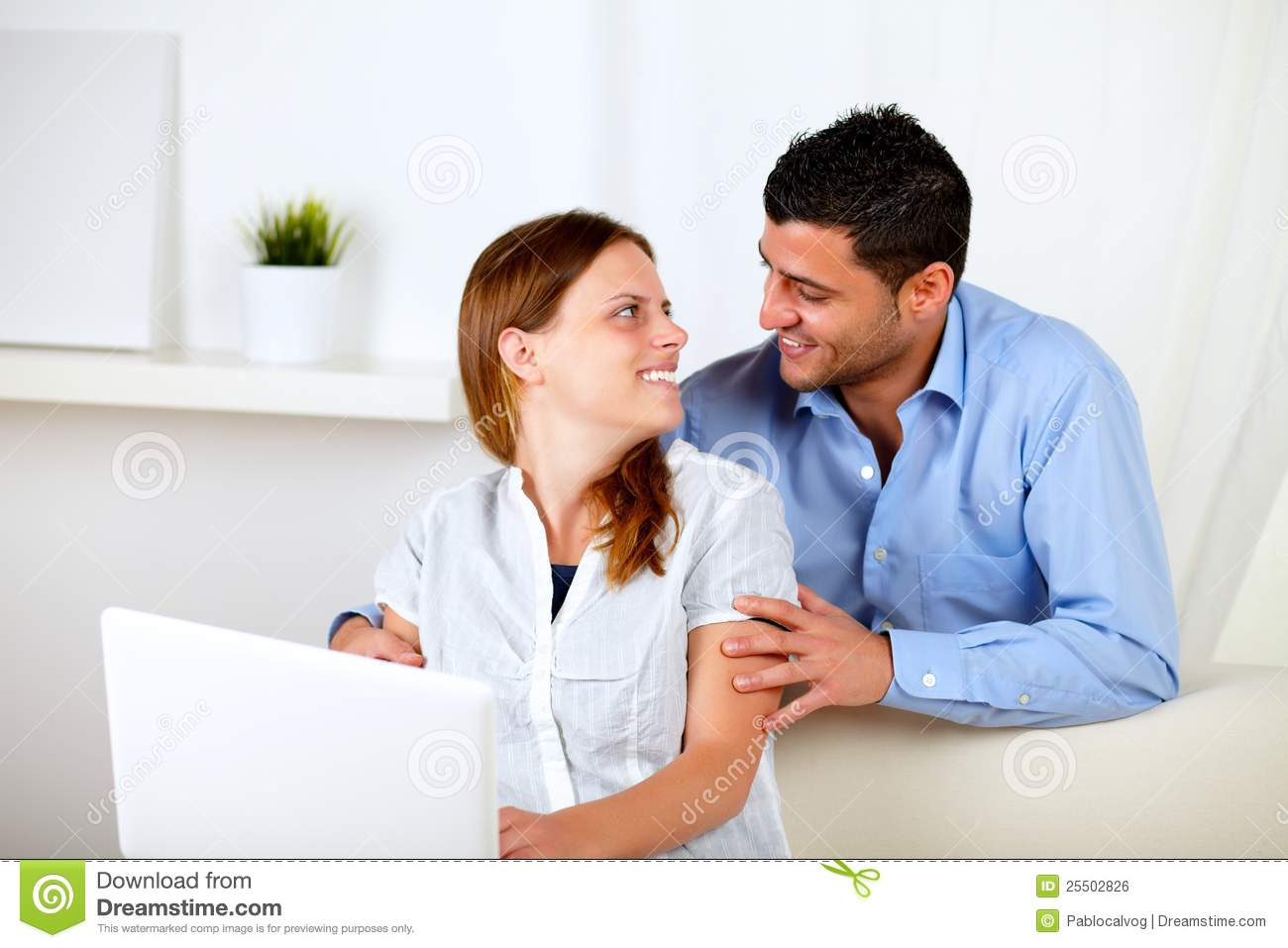 Couple in love using a laptop at home stock photo image for Lovers home