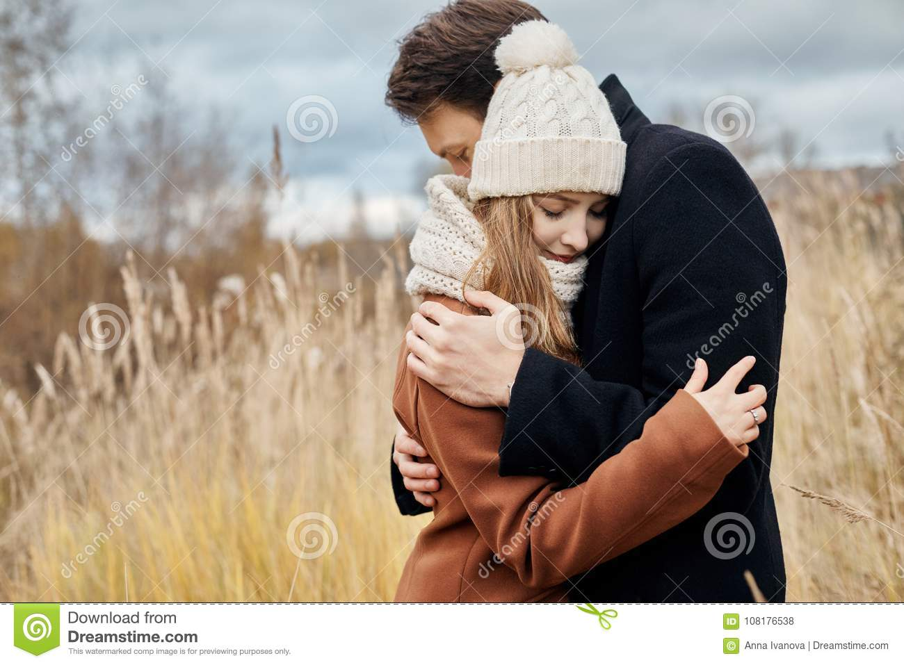 Couple in love walking in the Park, Valentine`s day. A man and a woman embrace and kiss, a couple in love, tender feelings