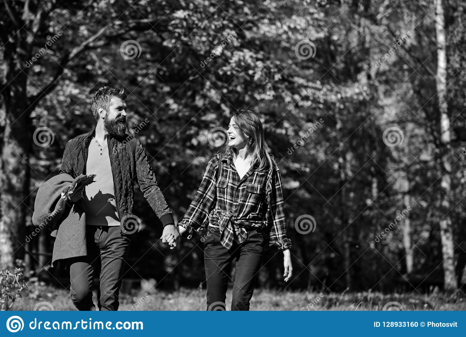 Couple in love walks in autumn park. Relationship and fall