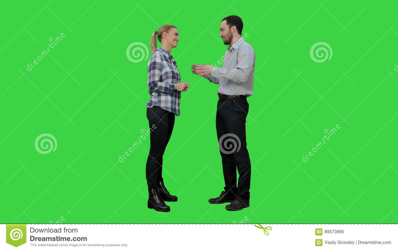 Couple Of Lovers Stand, Talk, Laugh On A Green Screen