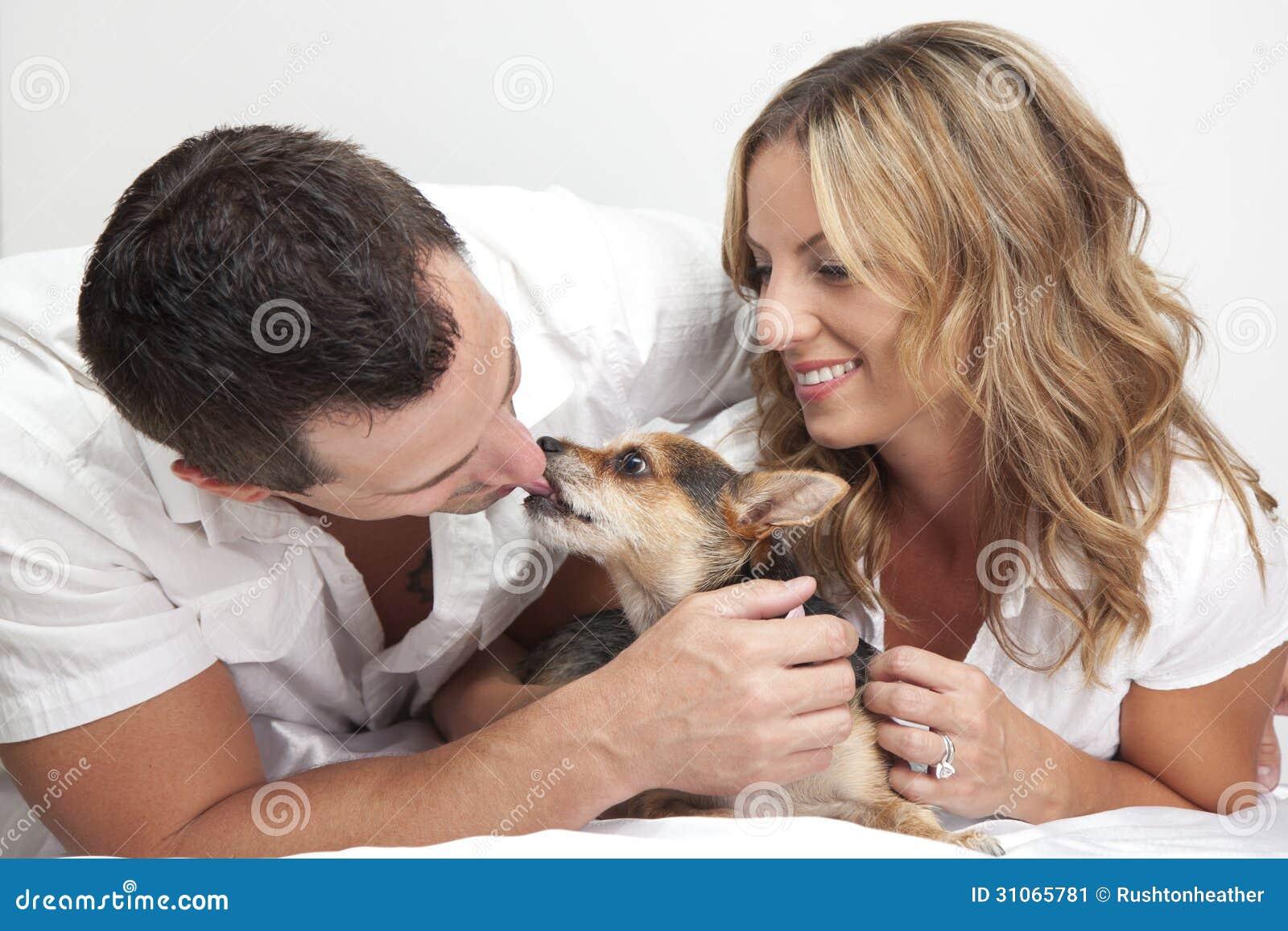 Couple Loving Pet Dog Stock Image Image 31065781