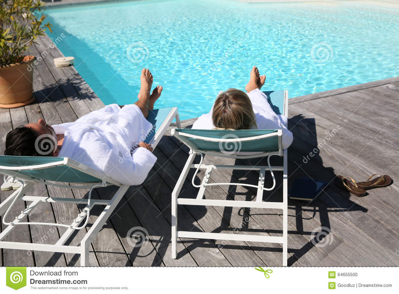 Couple In Luxury Resort By Swimming Pool Royalty Free