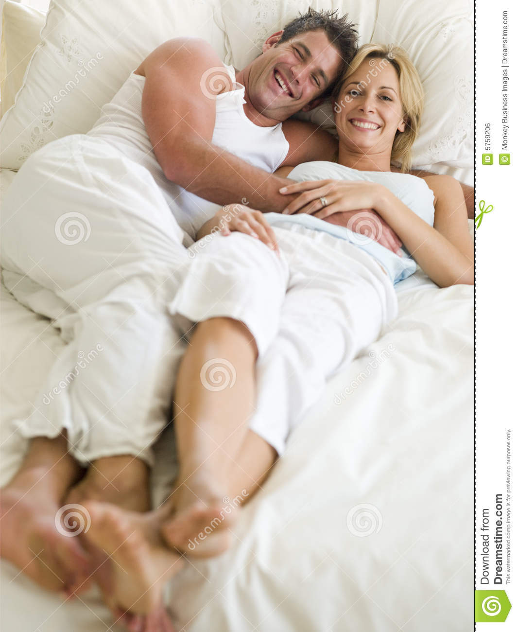 couple lying in bed smiling royalty free stock image image 5759206. Black Bedroom Furniture Sets. Home Design Ideas