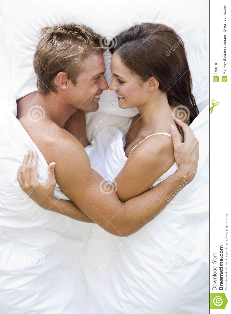 Couple Lying In Bed Smiling Royalty Free Stock Photography ...