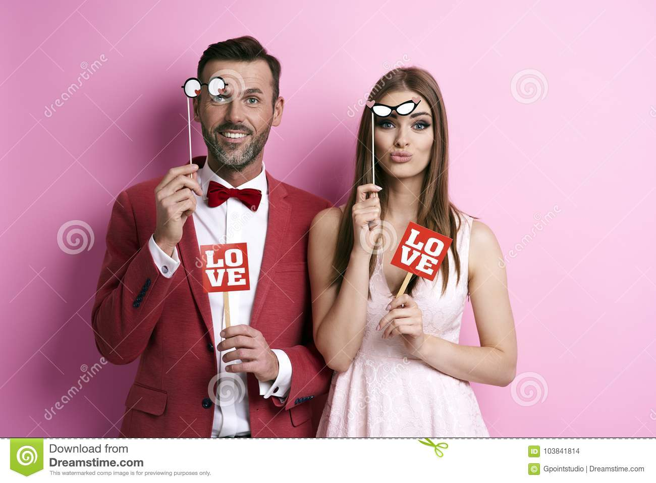 Couple making photos in photobooth