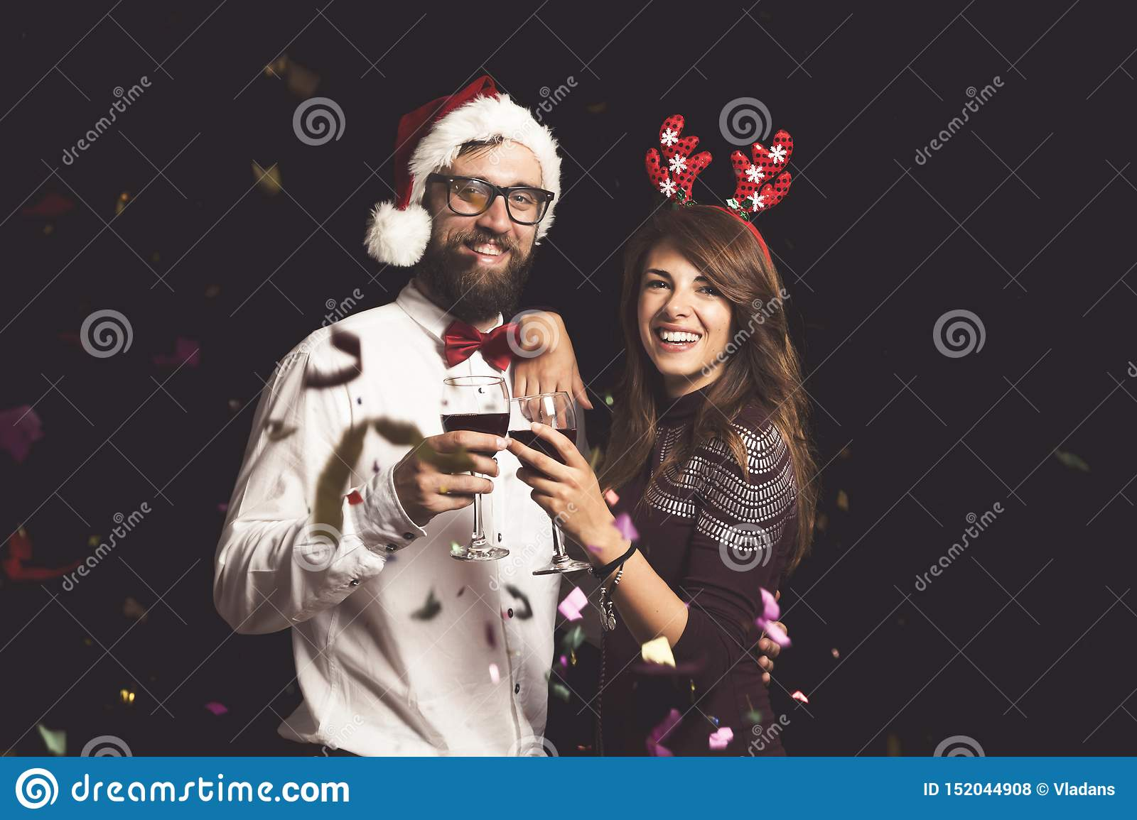 Couple making a toast at New Year`s Eve party