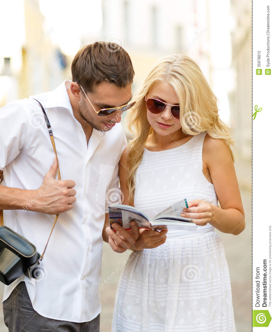 Couple Enjoying Their Summer Holidays Stock Photo: Couple With Map, Camera And Travellers Guide Stock Photo