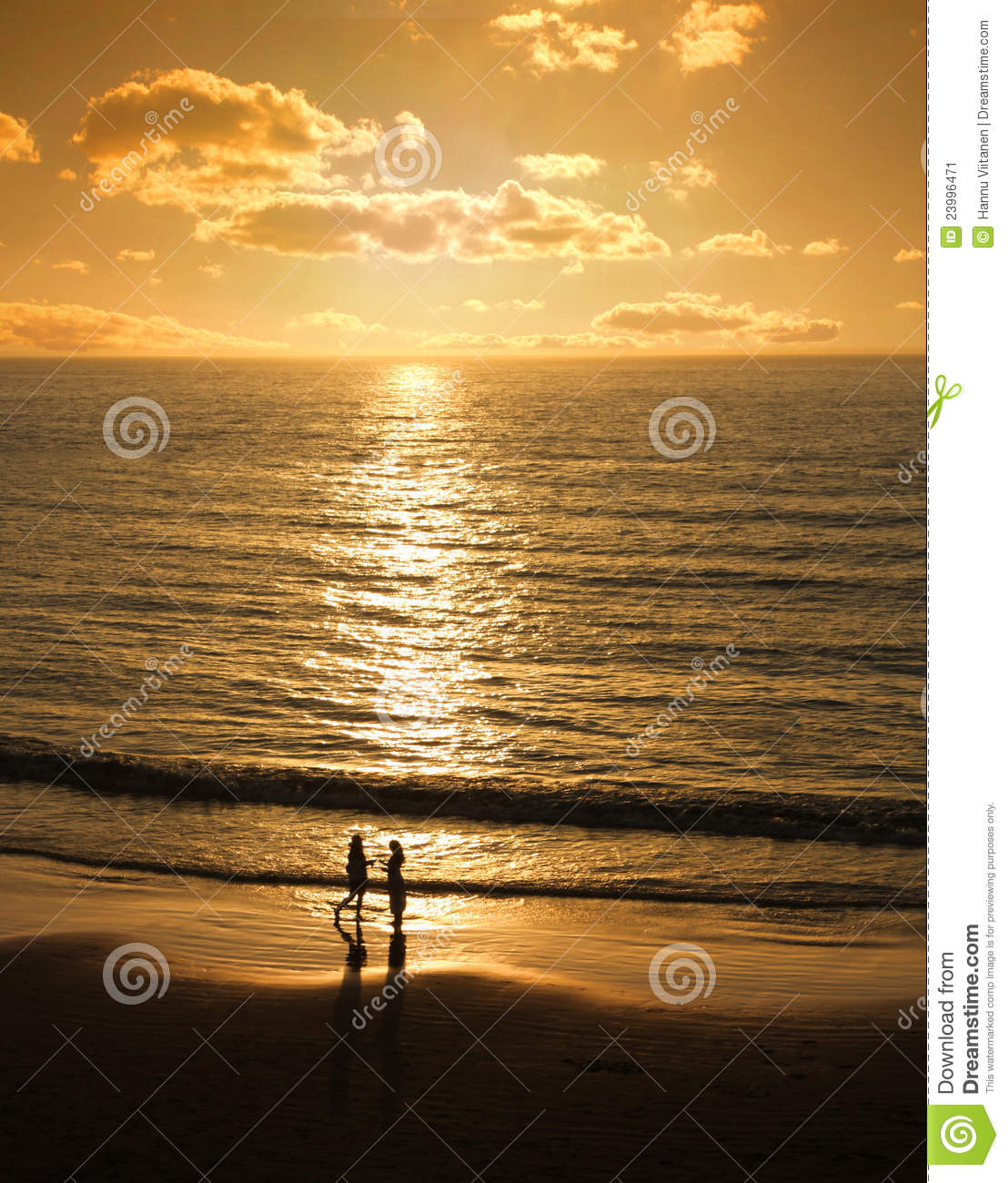 Couple Meets At Sunset Beach Stock Image