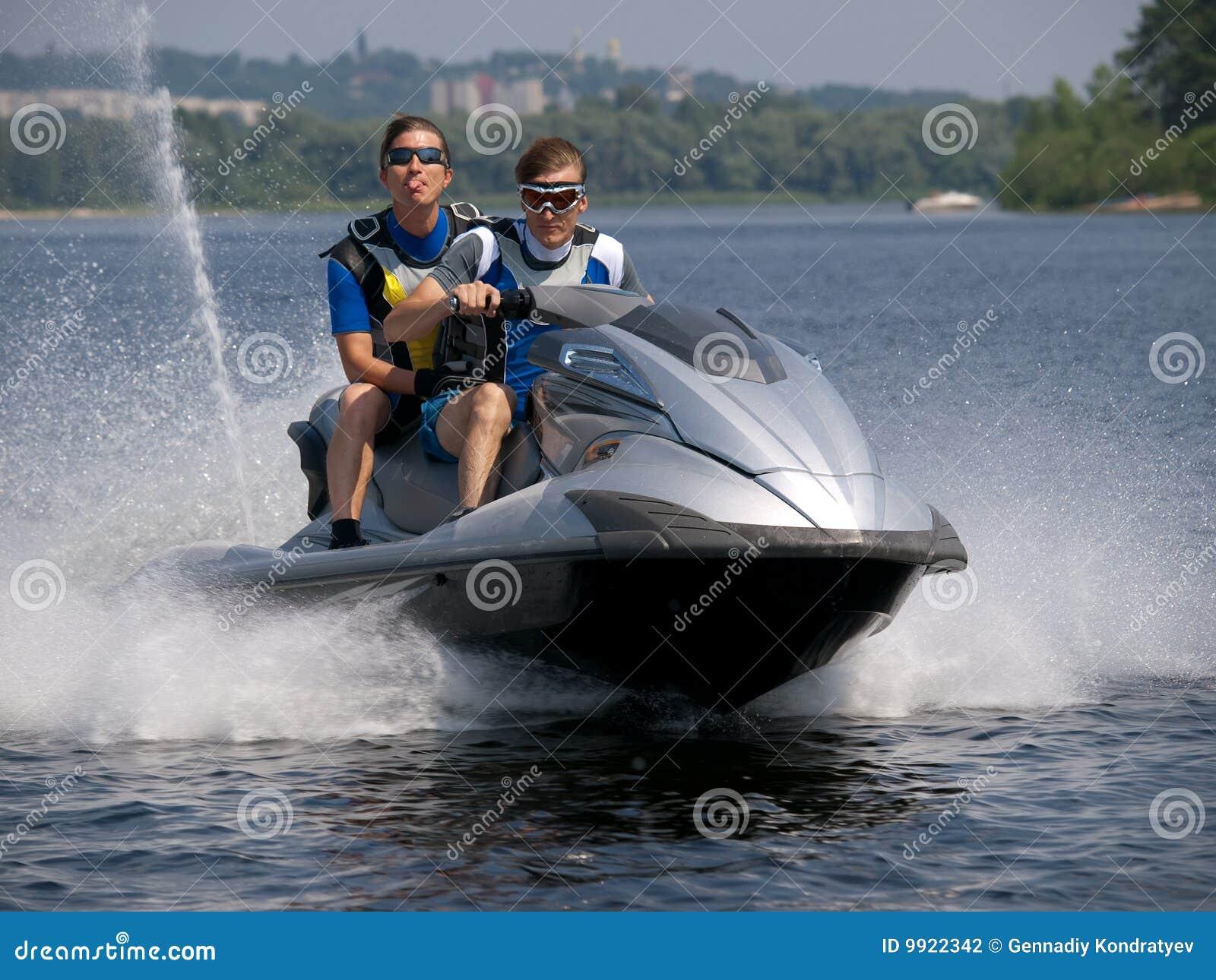 Ihram Kids For Sale Dubai: Couple Men On Jet Ski In The River Stock Photography