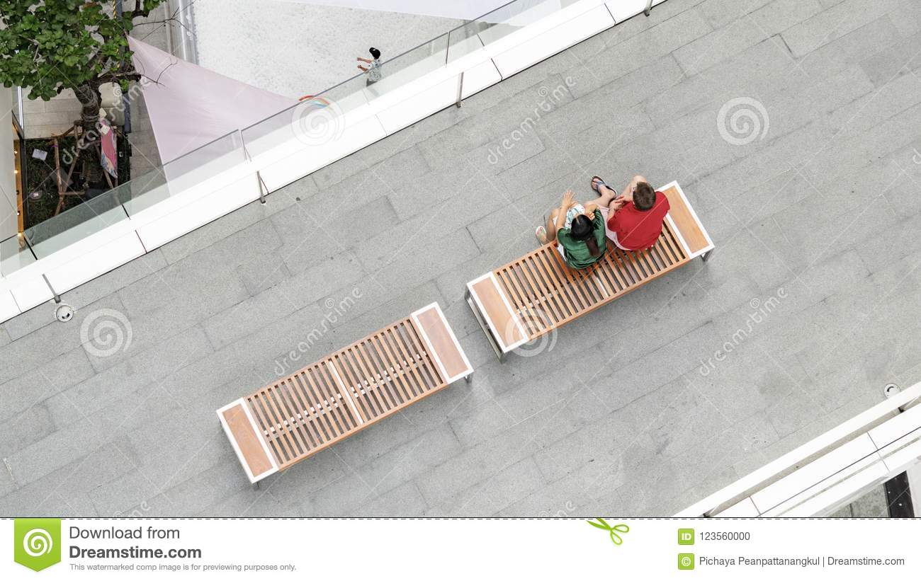 Cool The Couple Of Man And Woman In Love Sit On Wooden Bench At Ocoug Best Dining Table And Chair Ideas Images Ocougorg