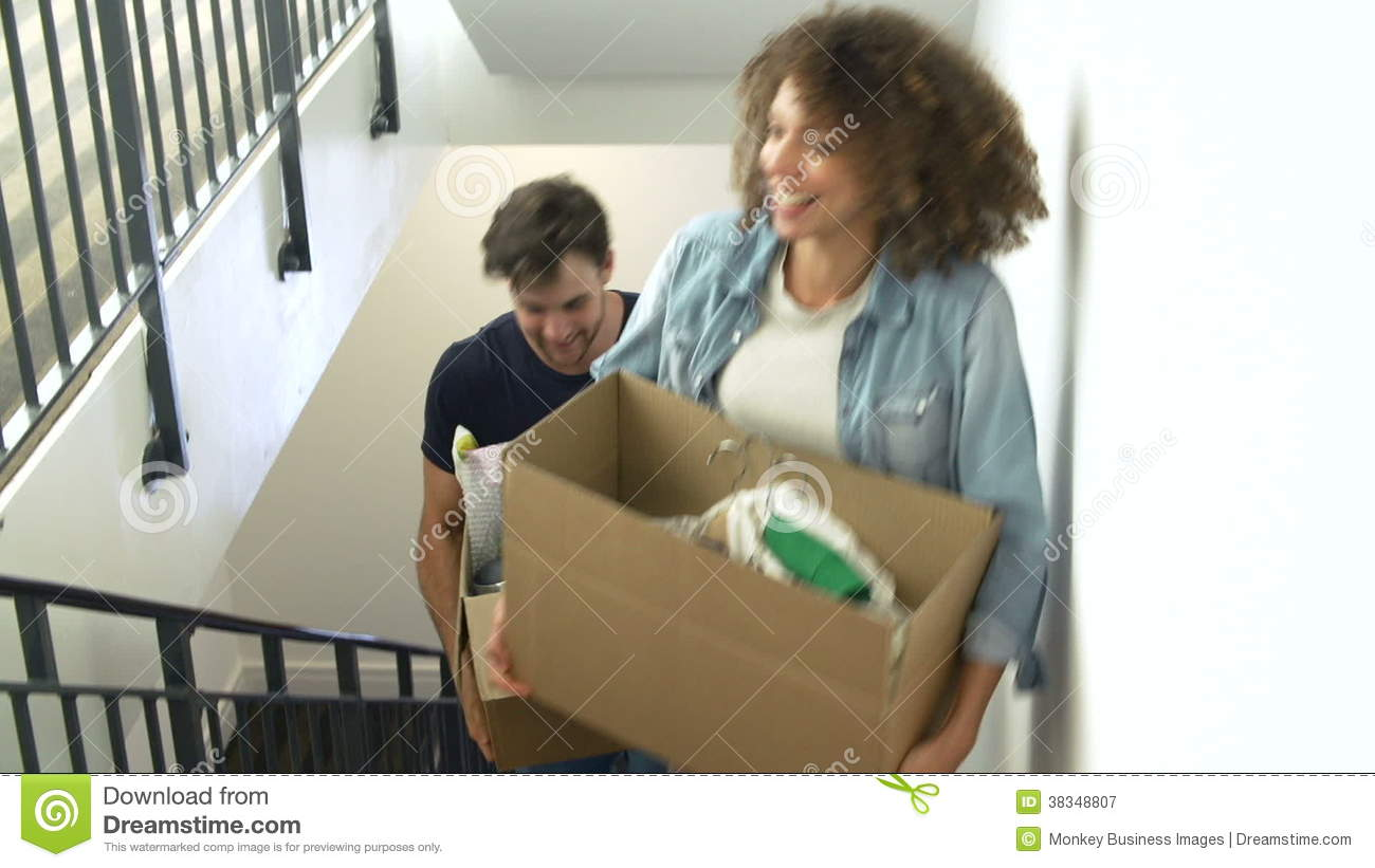 Couple Moving Into New Home Carrying Box Upstairs Stock Video ...