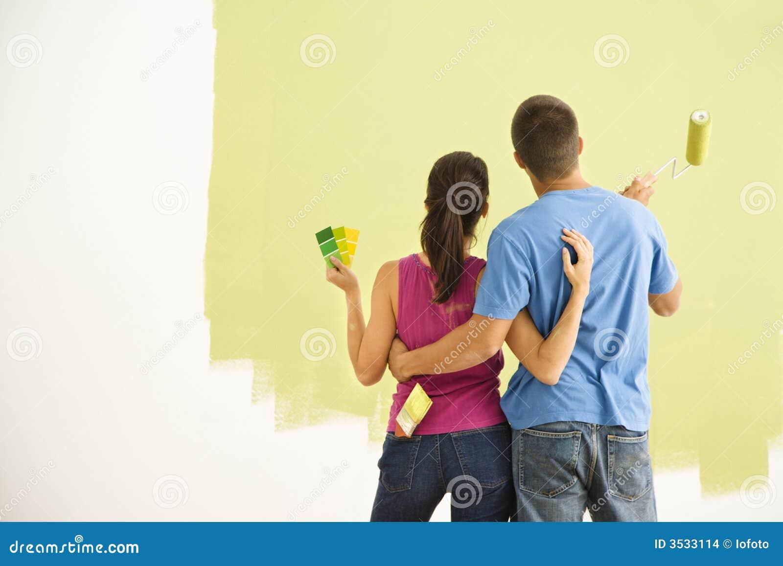 Couple painting home. stock photo. Image of female, improvement ...