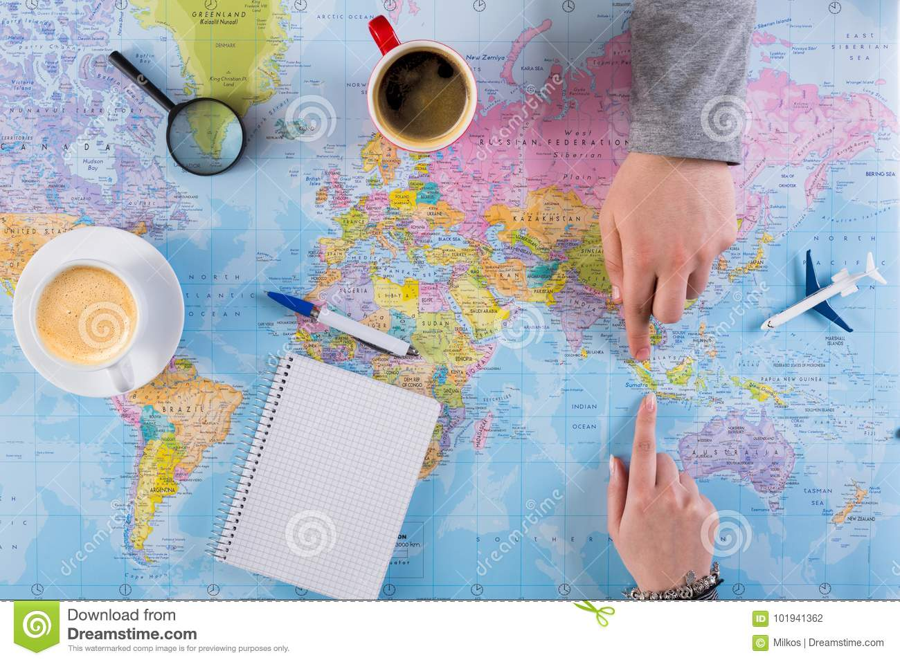 Couple planning trip to Indonesia, point on map