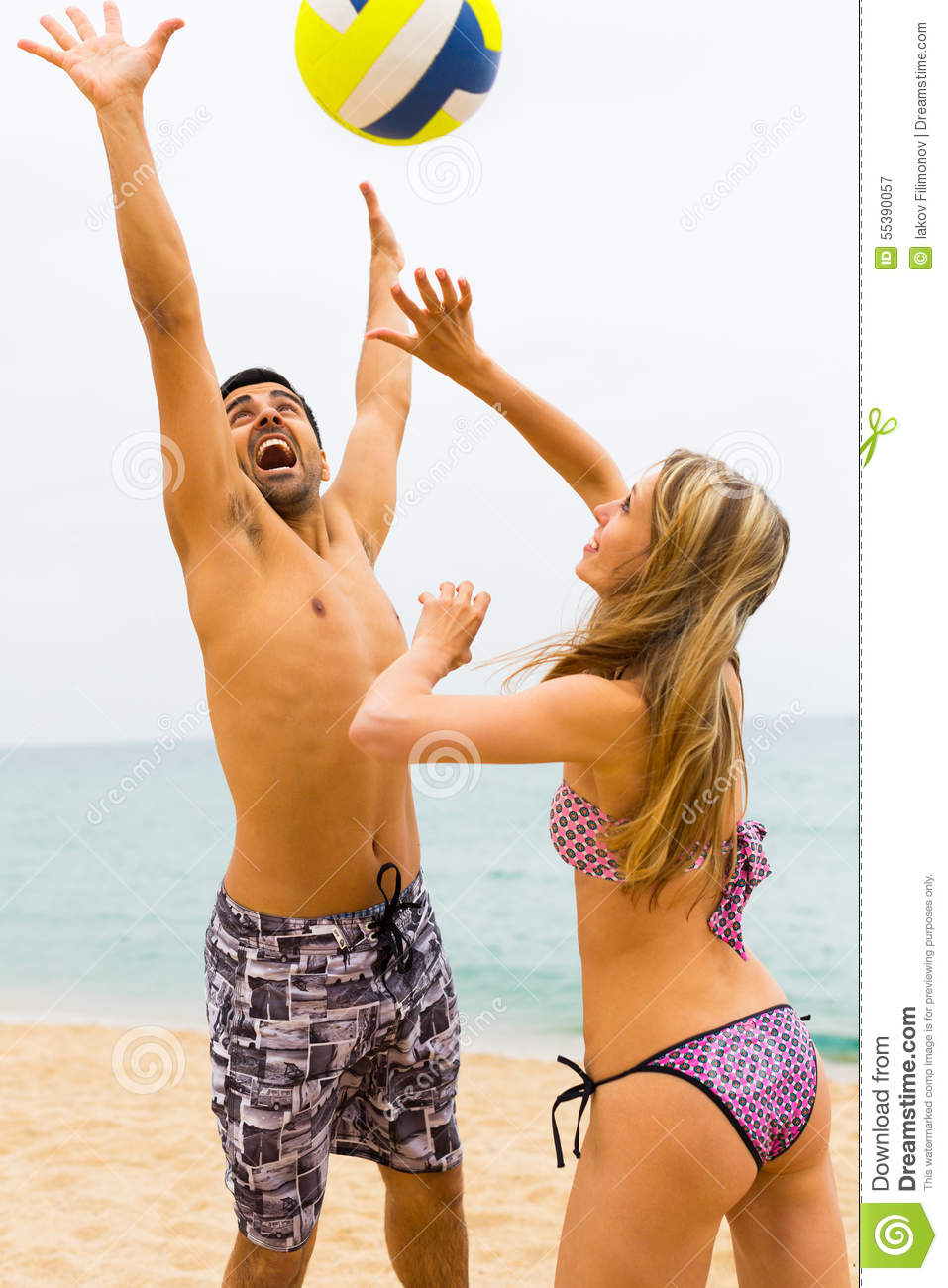 Couple playing with a ball on the beach