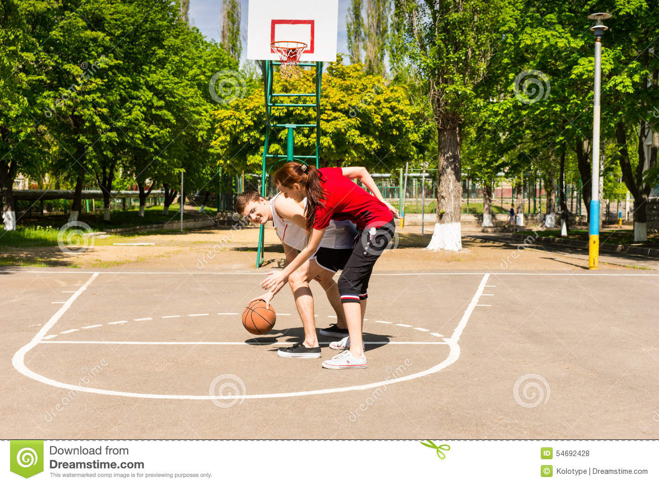 Couple Playing Basketball On Outdoor Court Stock Photo Image Of