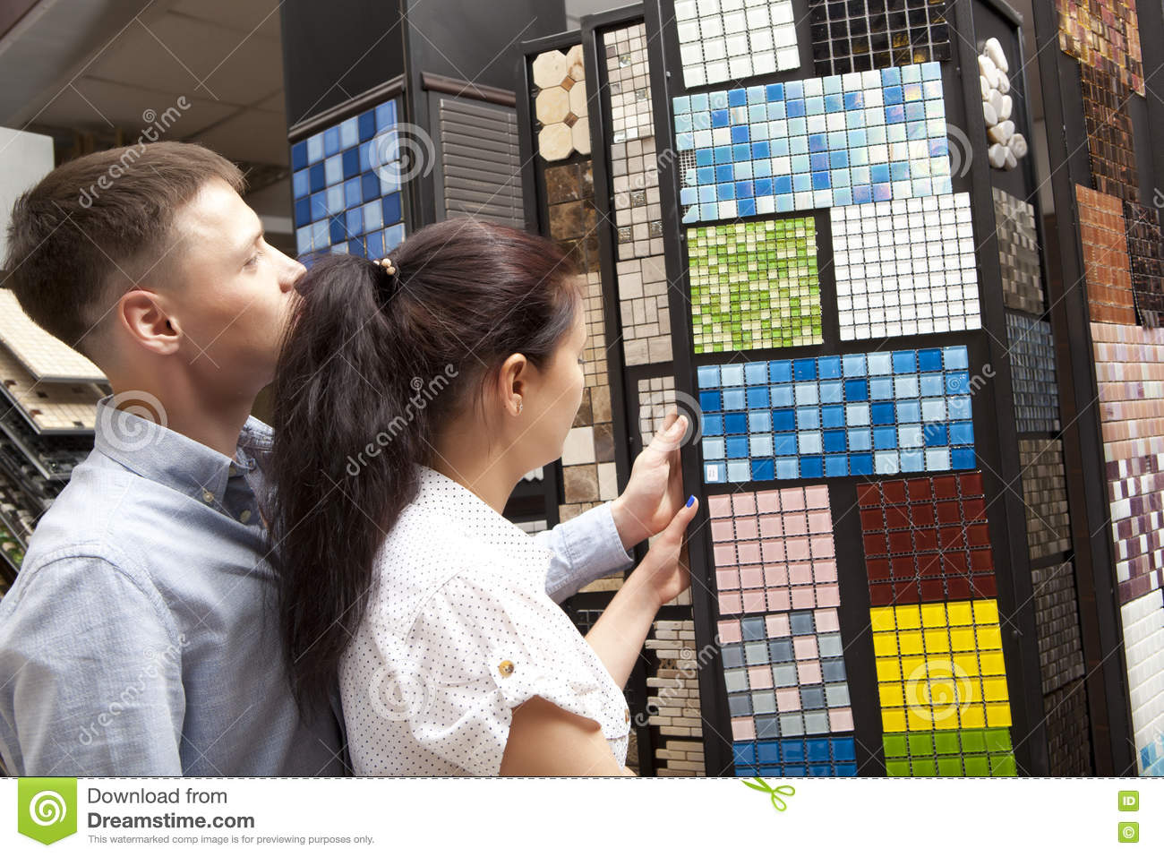 Download Couple Pointing At Ceramic Mosaic Tile For Bathroom Wall In Stor Stock Image - Image of decoration, improvement: 78910515