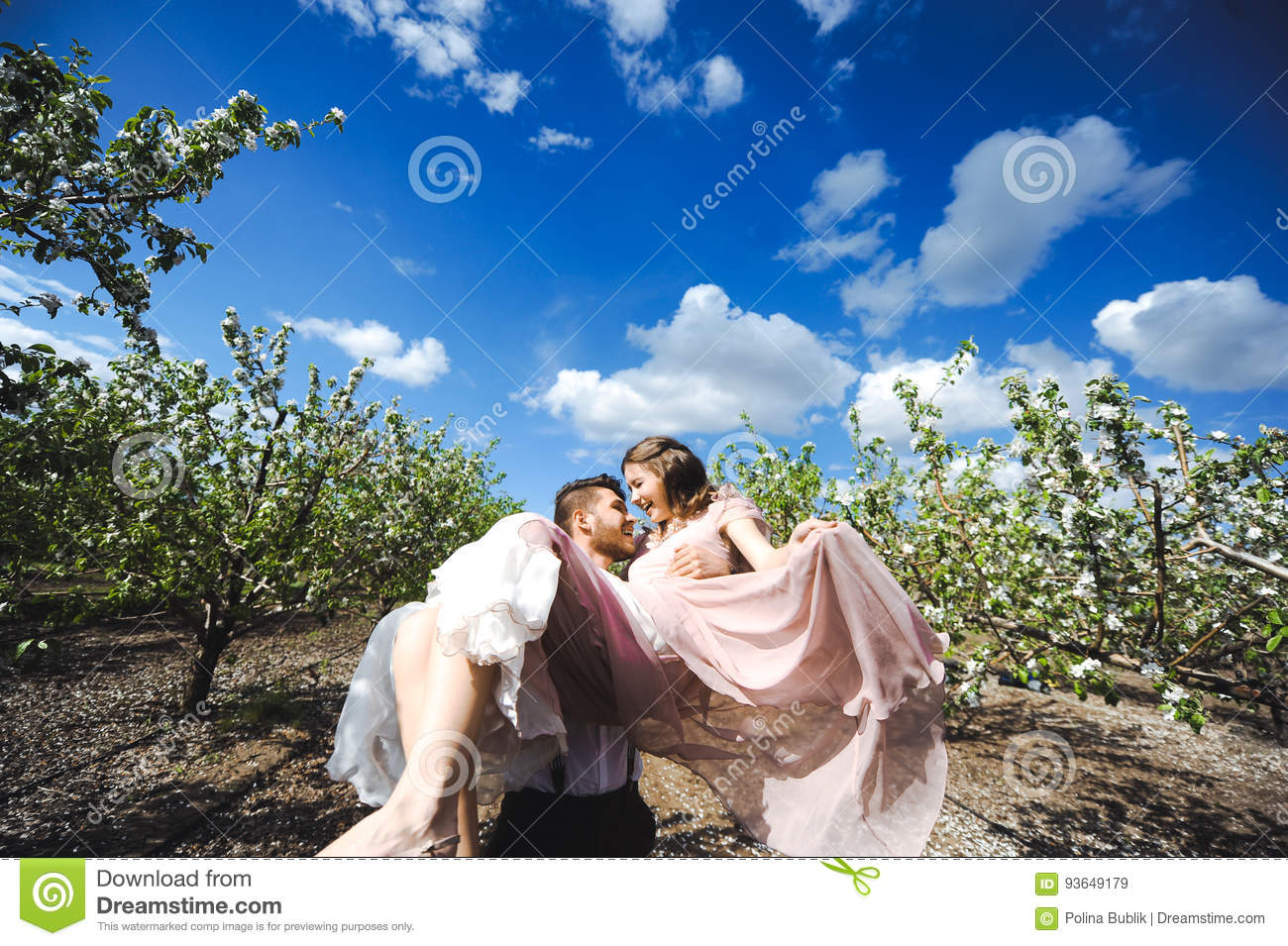 Couple Portrait Of A Girl And Guy Looking For A Wedding Dress A