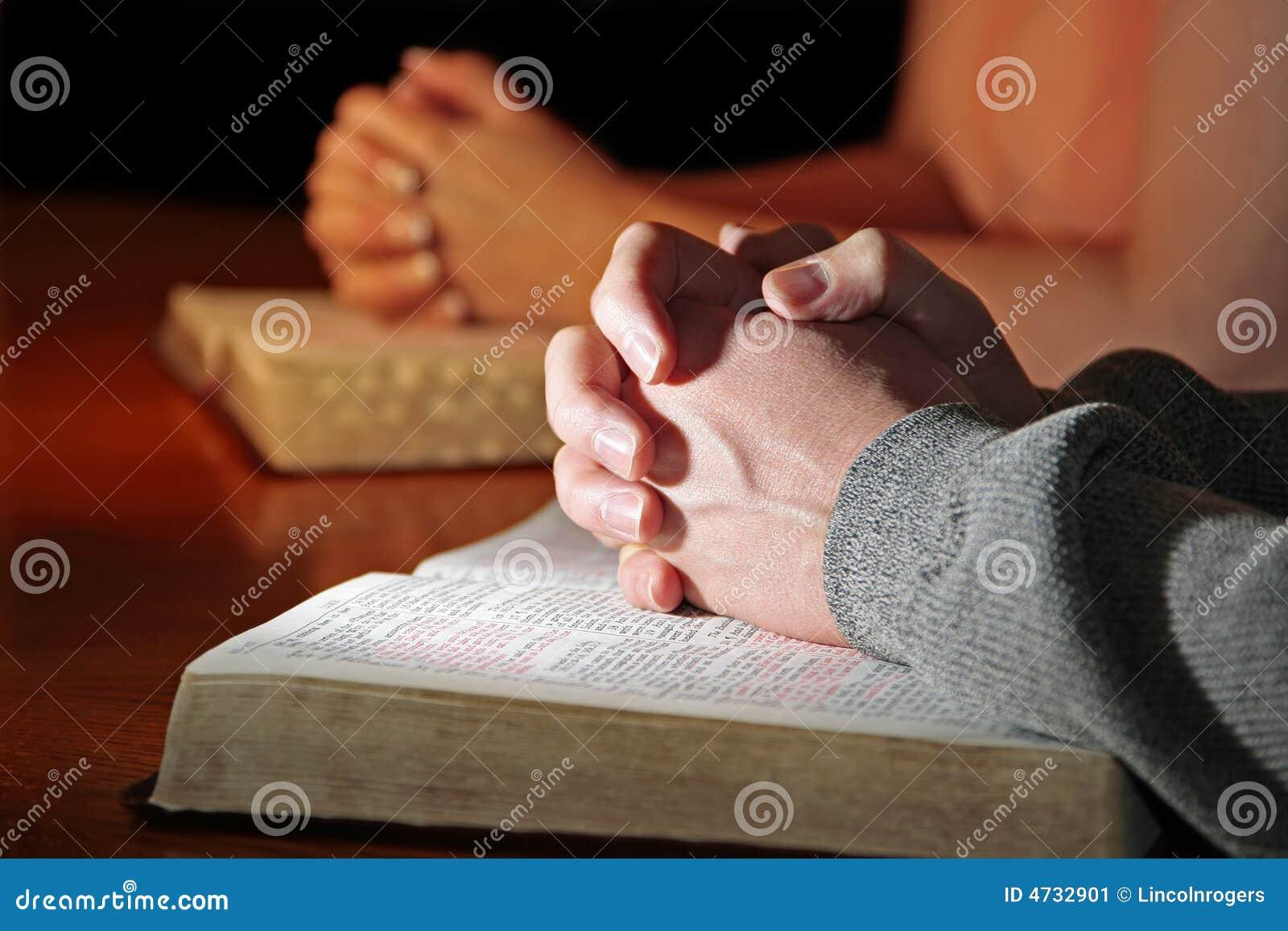 Couple Praying Bibles