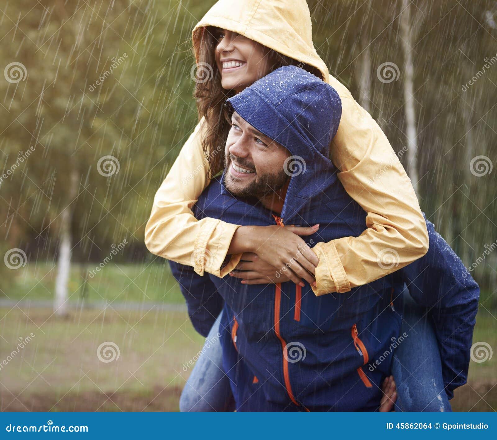 Happy Rainy Day: Couple During Rainy Day Stock Photo