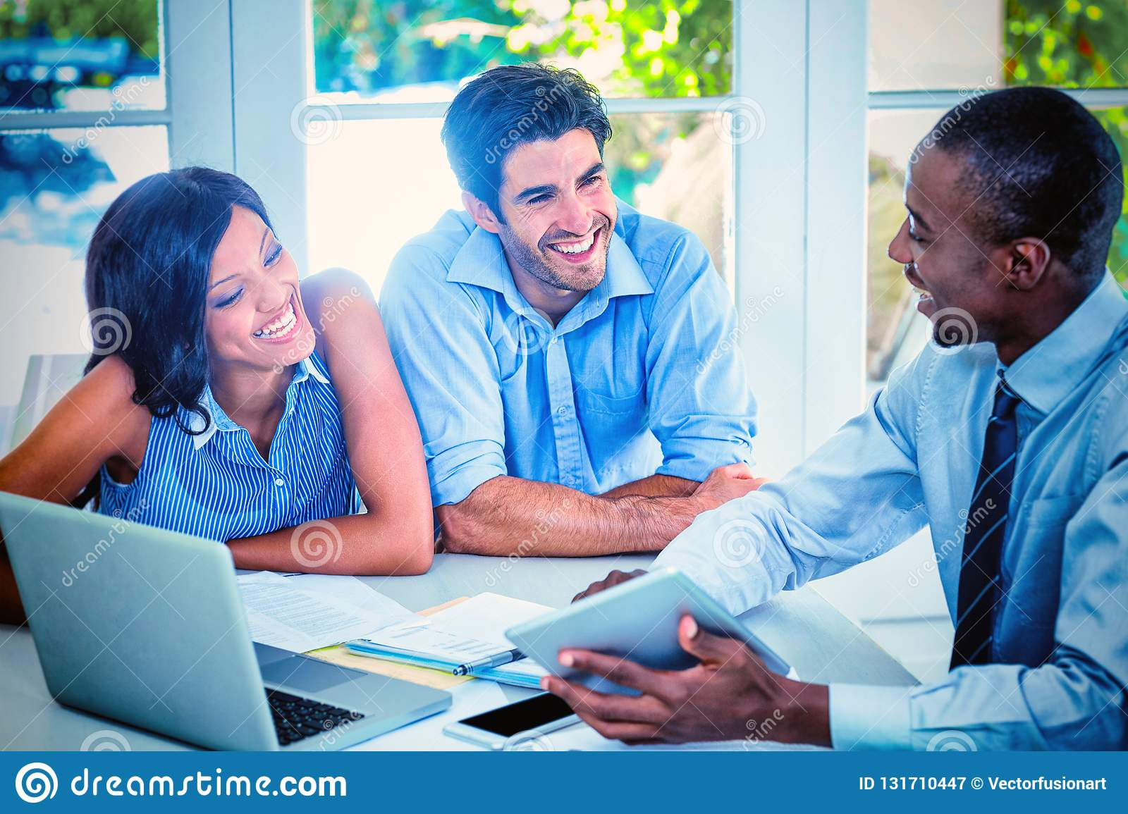 Couple and real estate agent discussing together
