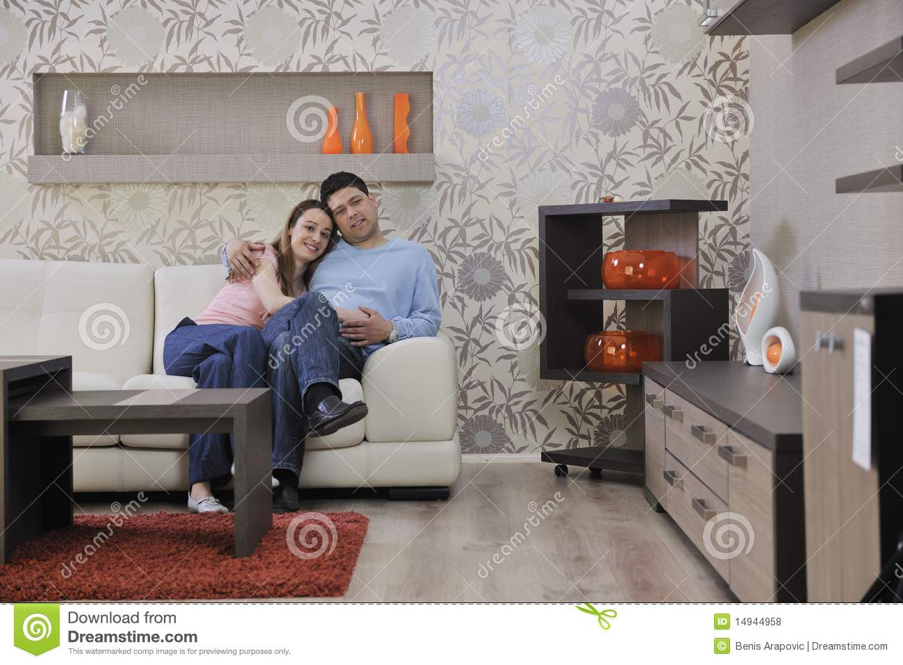 Couple relax at home on sofa in living room royalty free for Young couple living room ideas