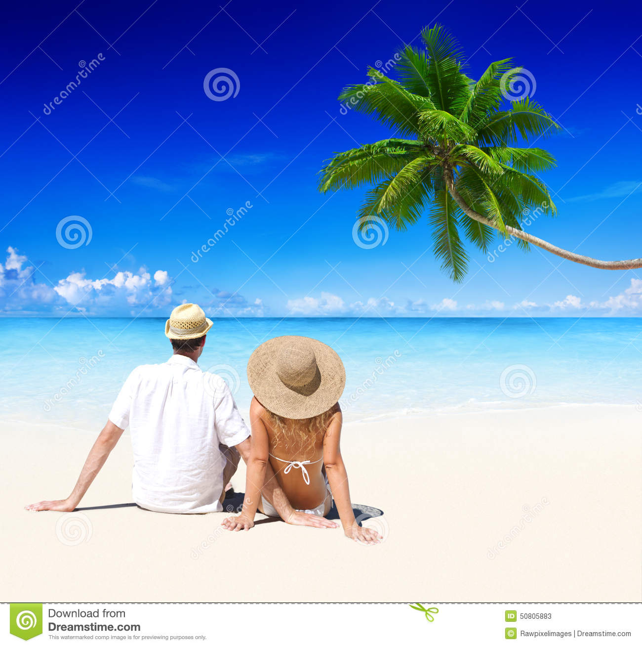 Couple Relaxing on the Beach Honeymoon Vacation Concept