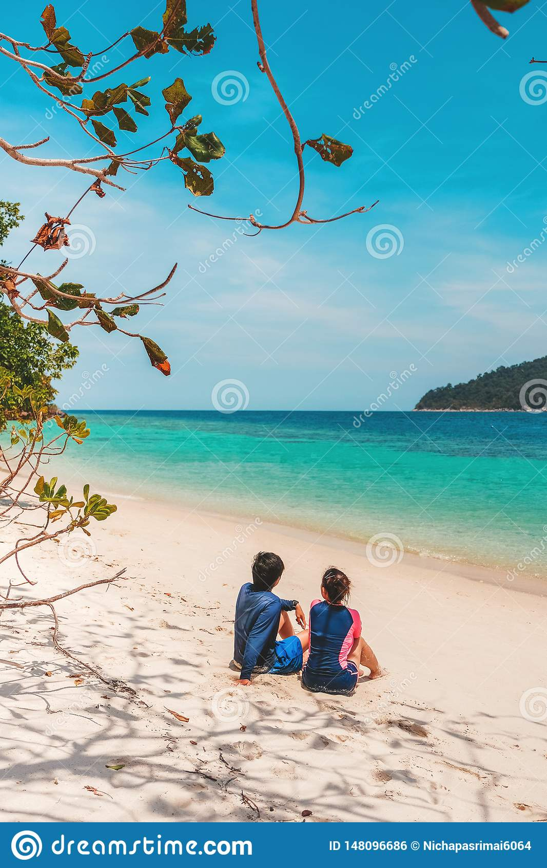 Couple relaxing on beach summer holiday
